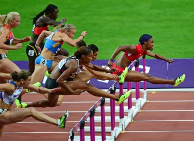 Finding Happiness Through Conquering Obstacles - Olympics: Track and Field-Women's 100m Hurdles-Semifinals