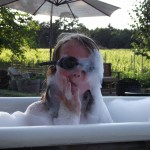 Bathing in our outdoor, clawfoot garden/vineyard tub.