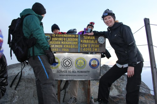 Finding my blogging niche: What kind of a traveler am I? Natasha at summit of Mt Kinabalu