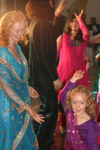 Natasha and Sofia dancing at an Indian wedding