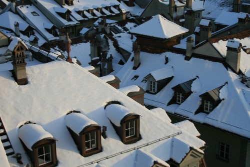 Holiday Travel Dreams: Top 8 Christmas Markets in Europe - Snow-covered roofs in Switzerland