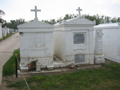 St. Bernard Louisiana after Hurricane Katrina: Terre aux Boeufs Cemetery; damaged above ground tombs with lines showing long standing flood water