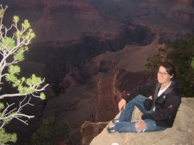 Katie sitting on the edge of the grand canyon