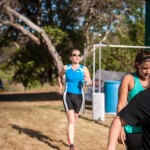 heather crosses the finish line at first sprint triathlon