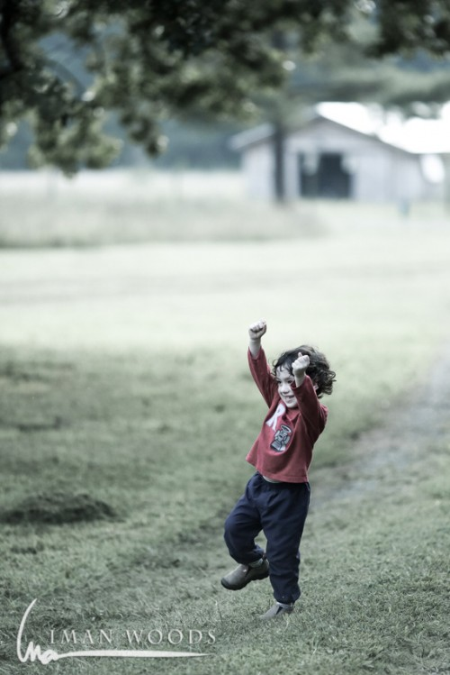 """WINNING. He ran a race around the yard and then screamed, """"I'm winning!"""" Taken with the 5D Mark iii and 135mm F2L."""